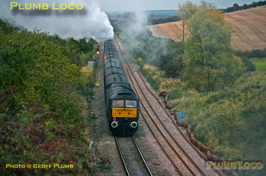 """After the water stop at Ridgmont station, 46233 """"Duchess of Sutherland"""" is slogging away to the summit of Brogborough bank with 47854 dead on the rear of the train in the fading light. This is 1Z87, the 16:13 return from Euston to Sheffield at 17:43 on Saturday 20th October 2012. Digital Image No. GMPI12701."""
