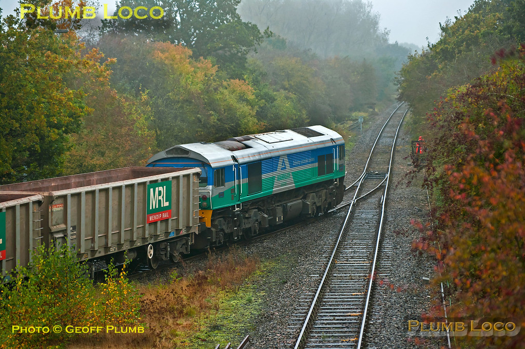 """The stone train from Merehead to Calvert and return has now been re-designated 6Z60 and 6Z61 and MRL 59005 """"Kenneth J. Painter"""" was in charge on Tuesday 23rd October 2012, a very dull and miserable day. The train has been fully unloaded this time and is departing a few minutes early at 11:04, en route to Claydon L&NE Junction to runround and return to Merehead Quarry. Digital Image No. GMPI12711."""