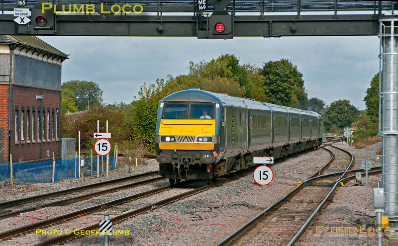"""From Monday 8th October 2012 Chiltern's LHCS """"Silver"""" sets were supposed to be strengthened to six coaches - here 1H32, the 10:55 from Birmingham Moor Street to Marylebone is passing Princes Risborough North Signal Box at 12:06 with 82301 leading and 67014 """"Thomas Telford"""" on the rear, but the set still comprises five coaches... Tuesday 9th October 2012. Digital Image No. GMPI12530."""
