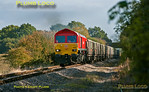Although this train was supposed to run from Monday 15th October 2012 for several days, it ran for the first time on Thursday 18th October 2012. The outward working was 7Z60, 02:28 from Merehead Quarry to Calvert, with arrival due at 06:30. 59203 is now working the return train, 7Z61, 11:05 from Calvert to Merehead, having run round in the loop at Claydon L&NE Junction  and now passing Charndon at 11:48, around twenty minutes late. Photo taken from a public footpath across the line. Digital Image No. GMPI12617.