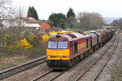 60096 passes Hatherley Loop in charge of 6V05 09.23 Round Oak to Margam empty steel carriers.