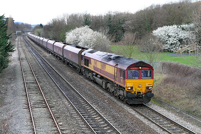 With 31 HTA's in tow 66109 has charge of 4E66 08.55 Margam to Redcar empty hoppers at Hatherley Loop.