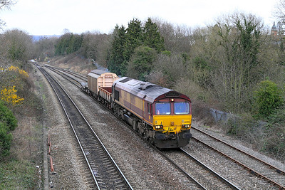 Not normally booked to run on a Friday 66006 passes Hatherley Loop with 6A36 Ashchurch to Didcot MOD service.
