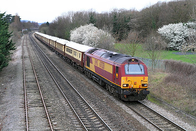 67028 brings the VSOE stock forming the 1Z88 07.05 London Victoria to Cheltenham race special past Hatherley Loop.
