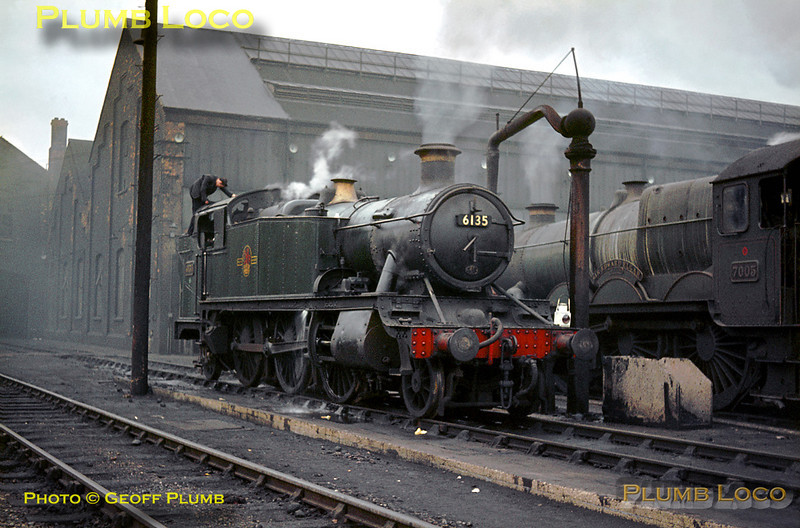 "GWR 6100 Class 2-6-2T No. 6135 is being prepared at Old Oak Common MPD and looks quite well looked after in its plain green livery. Alongside is not so well looked after ""Castle"" Class 4-6-0 No. 7005 ""Sir Edward Elgar"", having just come ""on shed"". Sunday 2nd February 1964. Slide No. 508."