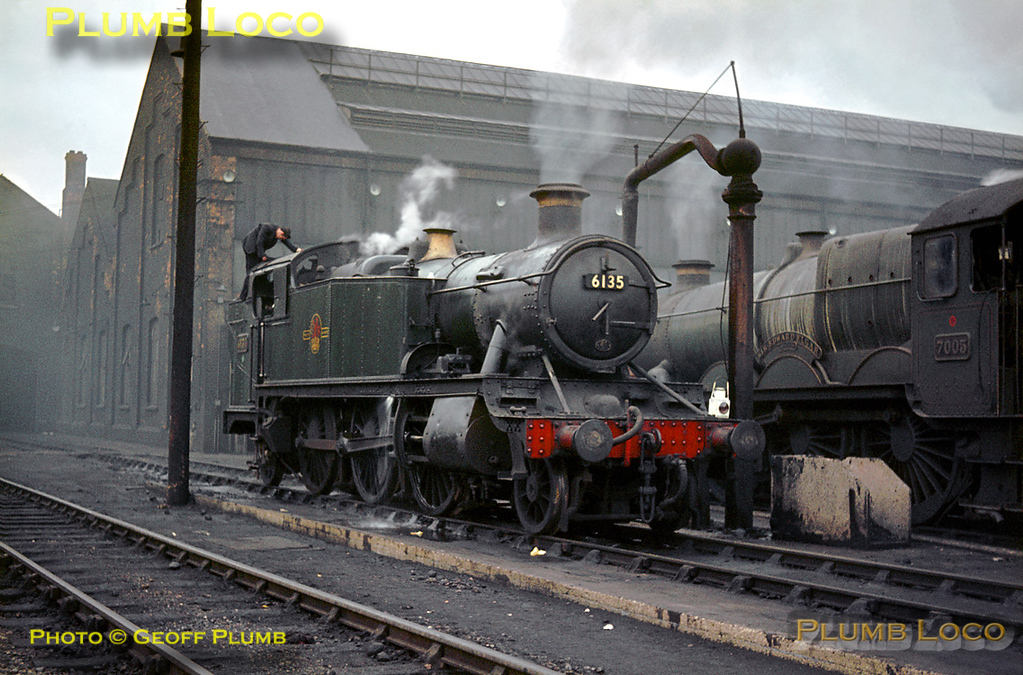 """GWR 6100 Class 2-6-2T No. 6135 is being prepared at Old Oak Common MPD and looks quite well looked after in its plain green livery. Alongside is not so well looked after """"Castle"""" Class 4-6-0 No. 7005 """"Sir Edward Elgar"""", having just come """"on shed"""". Sunday 2nd February 1964. Slide No. 508."""