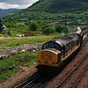 37152 departs Fort William Junction Yard with vans bound for the Corpach paper mill 27/5/1998.