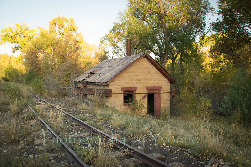 Pumphouse and tracks at the old Gato Station, Colorado