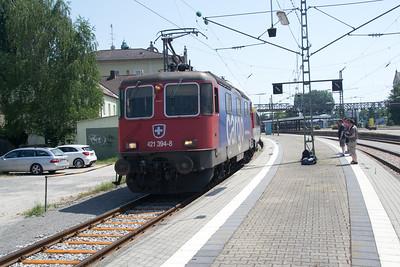 Onlookers aplenty as Re421-394 gets underway from Lindau - 04 Jul 2015