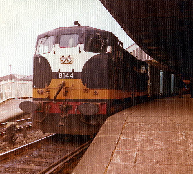 A liner (intermodal) train awaiting the signal to head through Cork en-route to the Cork container terminal at North Esk which was east of the city on the Cobh branch. It was opened in 1975 and closed in 2006 when IE virtually retired from the freight market.
