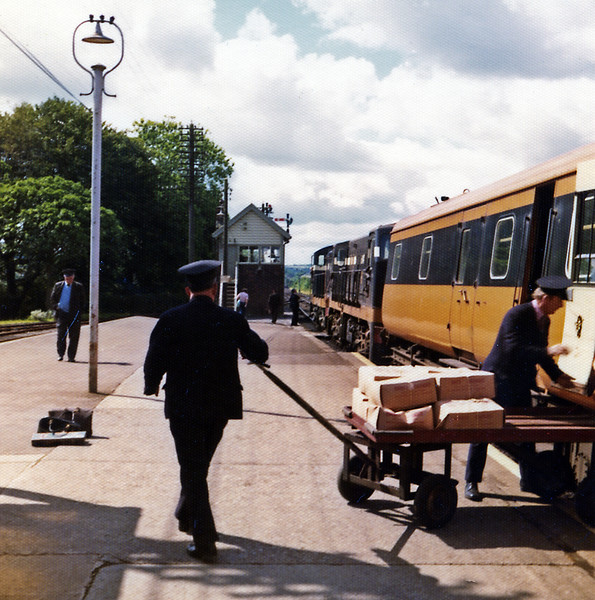 The 08:30 was double headed by a pair of the small GMs, one of the single cabbed 121 variety and one of the double cabbed 141s. At Mallow platform staff unload flowers from Sussex as the train prepares to leave, I changed for Tralee.
