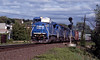 Finally from Palmer GE C40-8W heading west across the diamond with a manifest wagonload train heading for Albany.