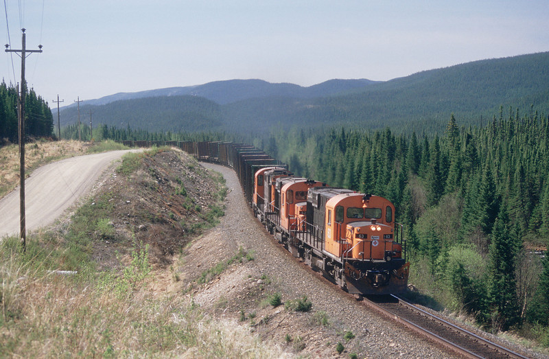 Near m.p.48 in the heart of the Reserve Faunique RS18 63 leads Uniforet empties up country.