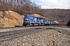 Climbing up the hill towards Horseshoe Curve a train of gondolas behind five units 6136 is a GE C40-8W
