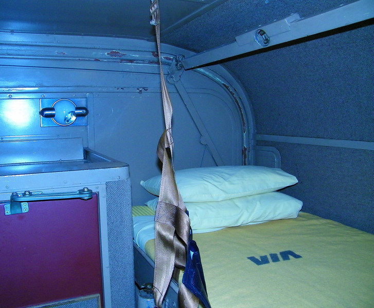 Upper bunk, toilet door at left.