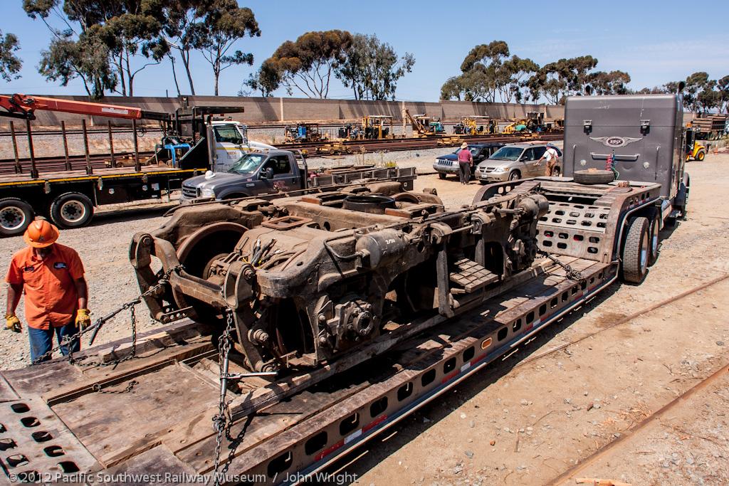 Rear trucks loaded on the trailer.