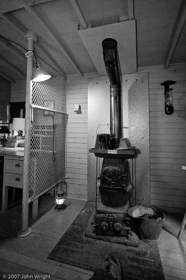 Coal burning stove in  ATCHISON, TOPEKA, & SANTA FE RAILWAY #1413 caboose  (And my foot...)