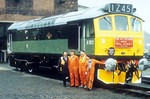A motley crew...L-R Traction Inspector Bob Fazakerley,Ken Tonks,Ian Parish and Paul Corrie pose with D7672 before her final journey.1991.