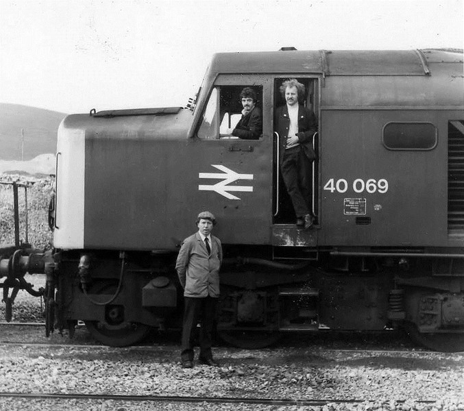 Ribblehead,a class 40 and 3 very young looking traincrew.L-R Driver 'Tony Wilson',Secondman in driving seat 'Alan Walker' and Guard 'Graham Clarkson' alias 'Nookie Bear'.Special thanks to Driver 'Gary Hardcastle' for identifying the traincrew.1980s.