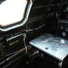 """Navigators seat in the cockpit of""""FIFI"""", the only  flying B-29 SUPERFORTRESS in the world.  Participants of the 2013 Chenault Air Show in Lake Charles, LA"""