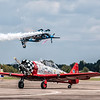 "The AeroShell Aerobatic Team and Pemberton Aerosports, described as ""the X Games act of airshows.  Participants of the 2013 Chenault Air Show in Lake Charles, LA"