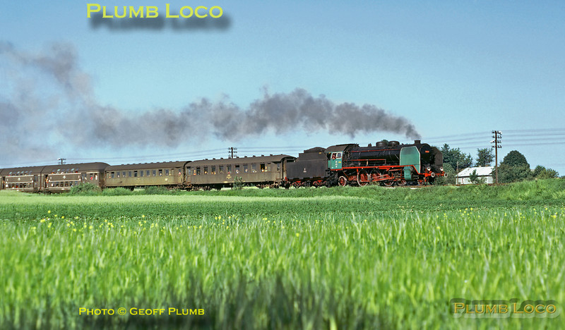 """PKP 2-8-2 No. Pt31-26 near Zemborzyce heading for Lublin with an early morning passenger train from Przeworsk, Monday 1st July 1974. This engine was unusual in having light green smoke deflectors, cylinder covers and cabsides - somebody's """"pet"""" engine perhaps? Slide No. 13010."""