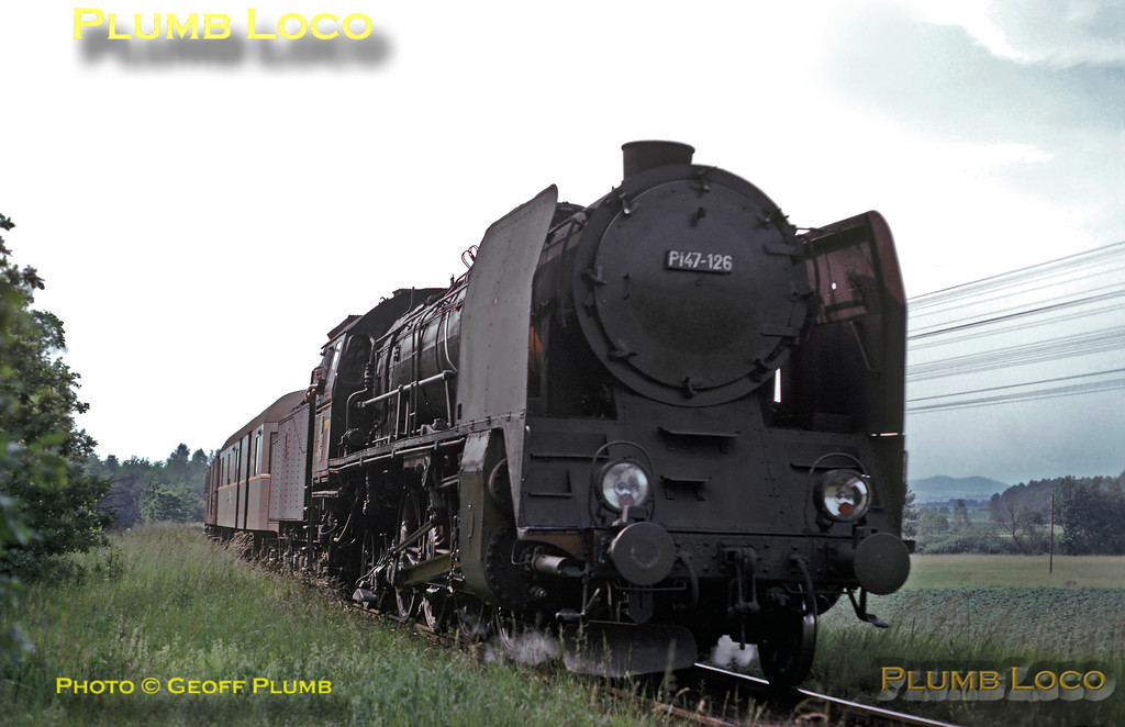 Polish built 2-8-2 No. Pt47-126 at the head of a semi-fast passenger train near Jaworzyna, this is the 14:32 Legnica to Nysa train. Although this is a relatively main line, like many others it is single track which is fairly overgrown, and of course, unfenced! Wednesday 26th June 1974. Slide No. 12941.