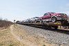 Flatcars bringing vehicles back to Moosonee.
