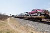 Flatcars bringing vehicles back to Moosonee.