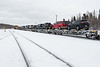 Polar Bear Express locomotives handling the loading and loading of vehicles on flatcars.