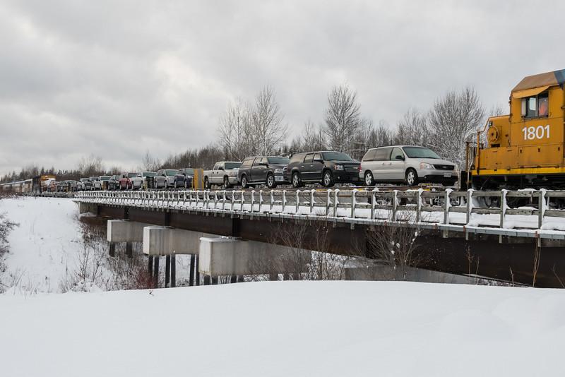 Vehicles on flatcars arriving in Moosonee on the Polar Bear Express mixed train.