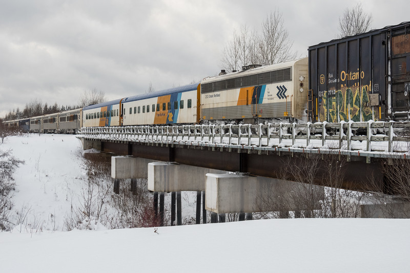 Polar Bear Express crossing Store Creek into Moosonee. Seven coaches and two APUs today.