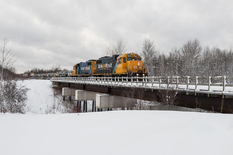 GP38-2s 1802 and 1801 lead the Polar Bear Express mixed train into Moosonee.