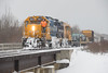 GP38-2 1801 leads the Polar Bear Express across Store Creek in Moosonee 2017 November 24th.