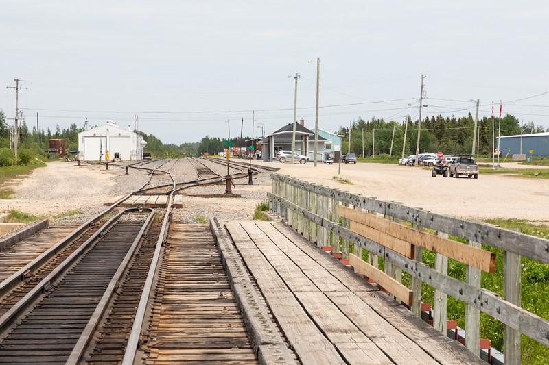 Looking towards Moosonee station from railway bridge over Store Creek 2018 July 1.
