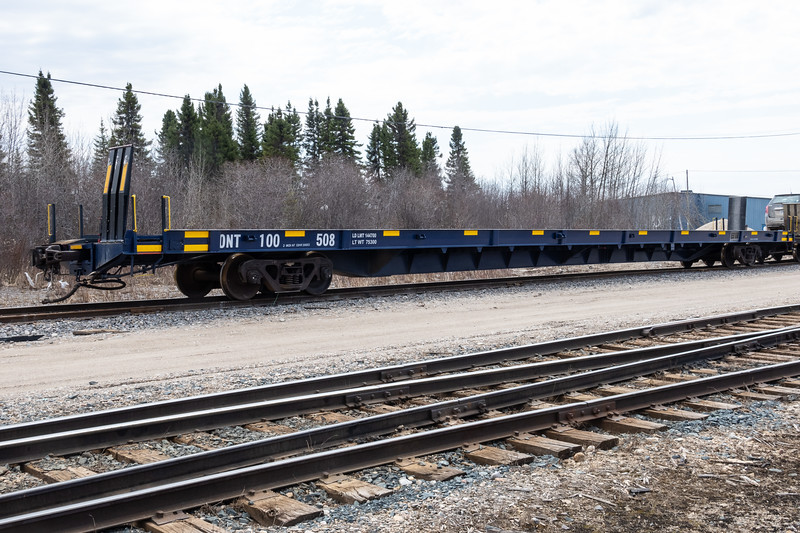Flatcar ONT 100508 for carrying vehicles on the Polar Bear Express. Chain car with no chains.