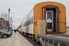 Polar Bear Express passenger consist led by coach 851 behind flatcar 100500.