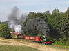 On a glorious morning Sir Cecil A Cochrane is seen storming out of East Tanfield with a demonstration coal train with Twizell assisting as banker 		09/09/2012