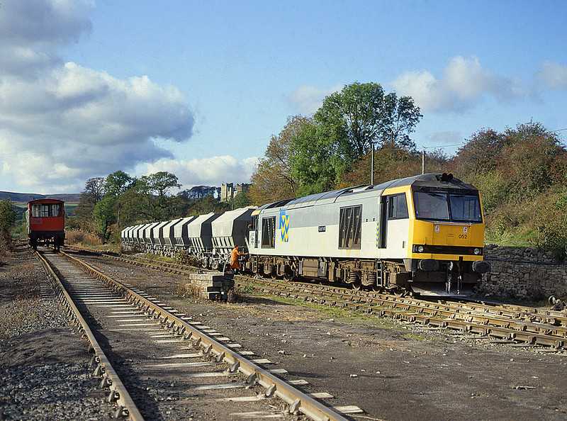 60052 is seen at Redmire collecting the loaded Limestone wagons before departure to Teeside<br /> 16/10/1992