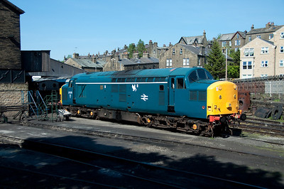 37075 basks in the sun outside Haworth shed viewed from a passing train 27/5/12.