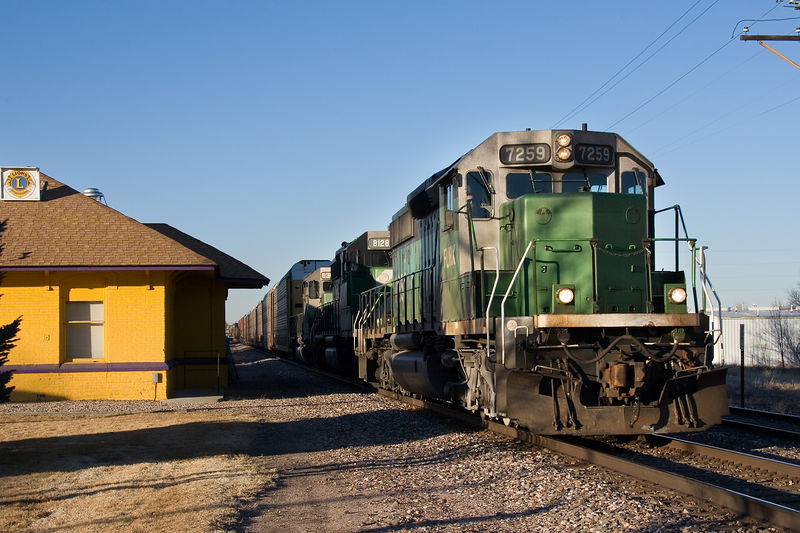 Racks and stacks fly southbound past the former C&S depot in Berthod, CO on January 22, 2006.