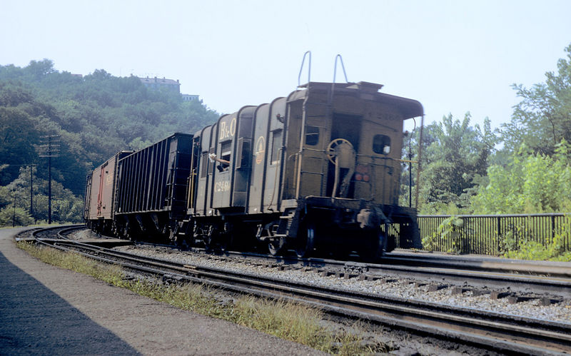 The conductor waves to Harper's Ferry station agent on a muggy August day in 1970.