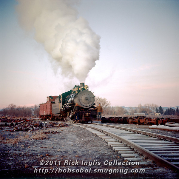 Slide No. 120. GW #75 and caboose. An early winter dawn, frost still on the ties, Loveland yard?
