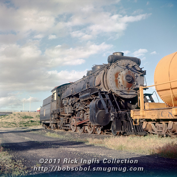 Slide No. 294. Burlington pacific #374 sits cold and partially stripped in the dead line, June 1957