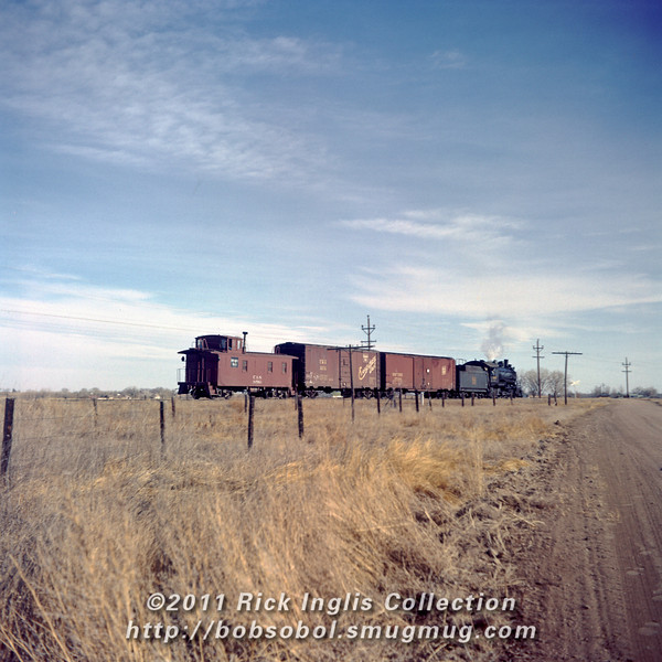 Slide No. 155. Caboose 10583 was the last wood caboose to operate on the C&S. It is now preserved at the Greeley Freight Station Museum.