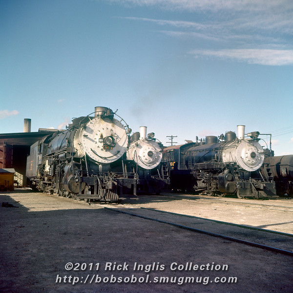 Slide No. 389. C&S 804, 648 and 647 simmer outside the Fort Collins engine house.