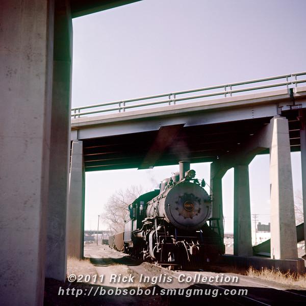 Slide No. 221. C&S 605 backing south under I-70 in Denver.