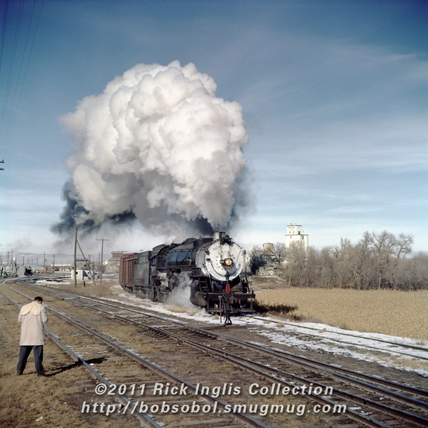 Slide No. 375. Greeley Local behind C&S 806 in Fort Collins along Riverside St. November 1958.