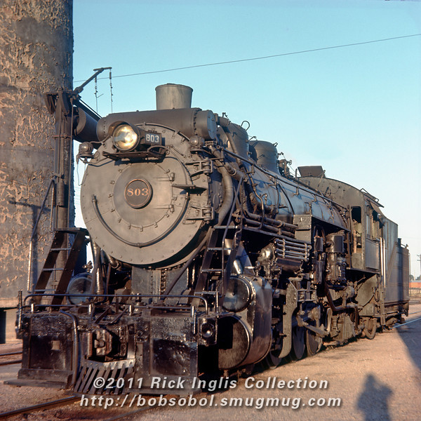 Slide No. 1558. C&S E-4A 2-8-2 803 in Cheyenne, WY 8/57.<br /> Also Photographer Bill Grave's shadow portrait.