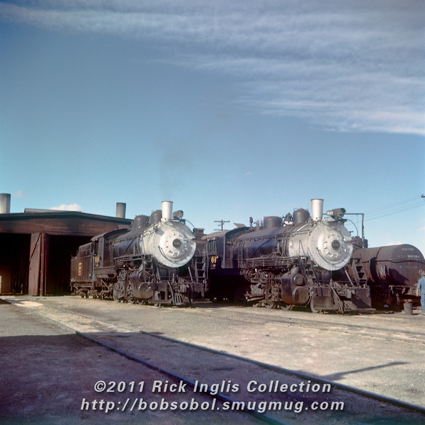 Slide No. 388. C&S 648 and 647 simmer outside the Fort Collins engine house.